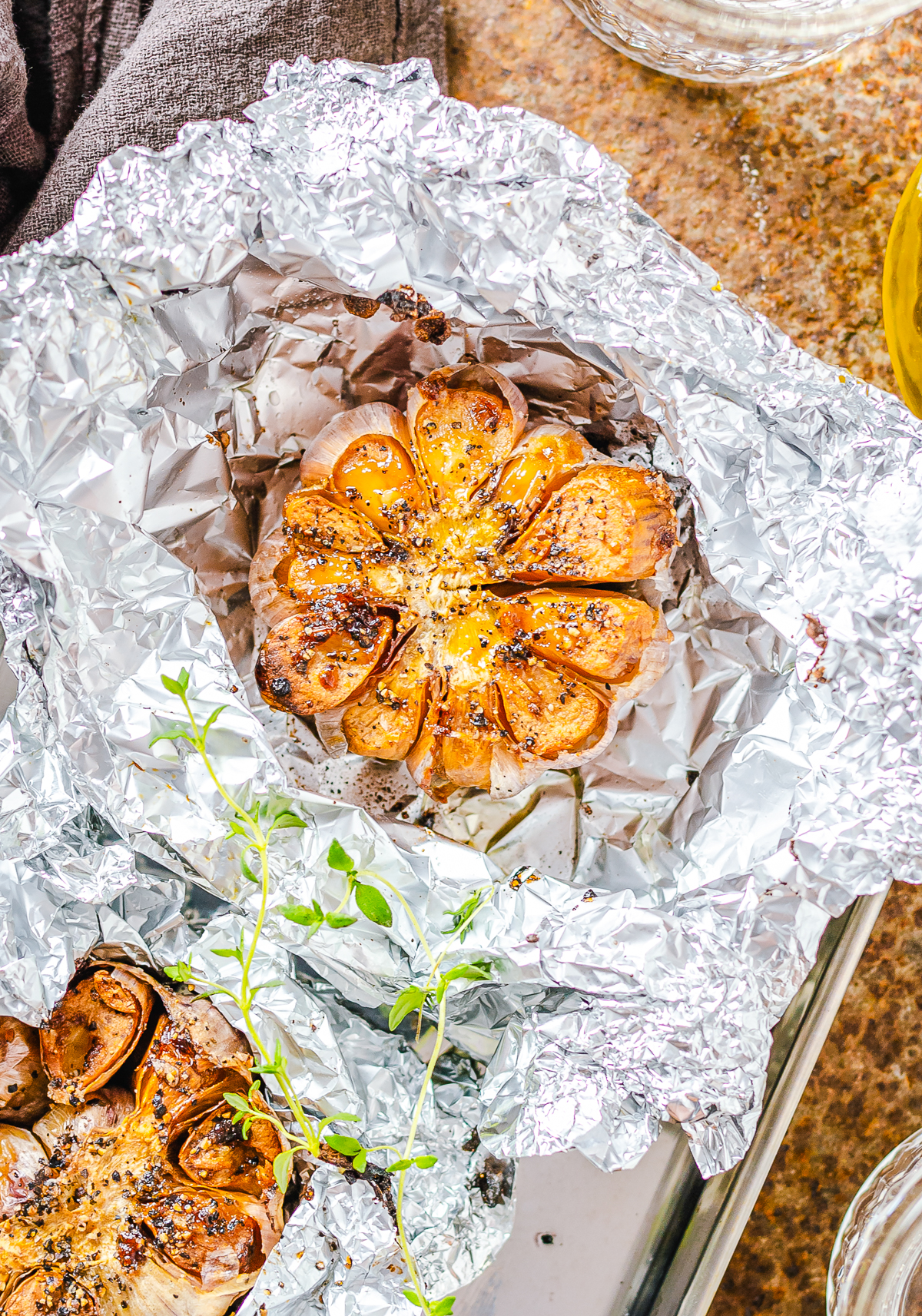 How to Roast Garlic finished in foil overhead.