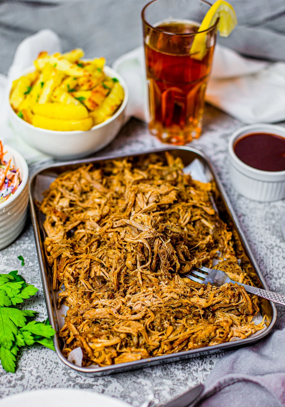 Crock Pot Pulled Pork on tray with form and French fries in bowl