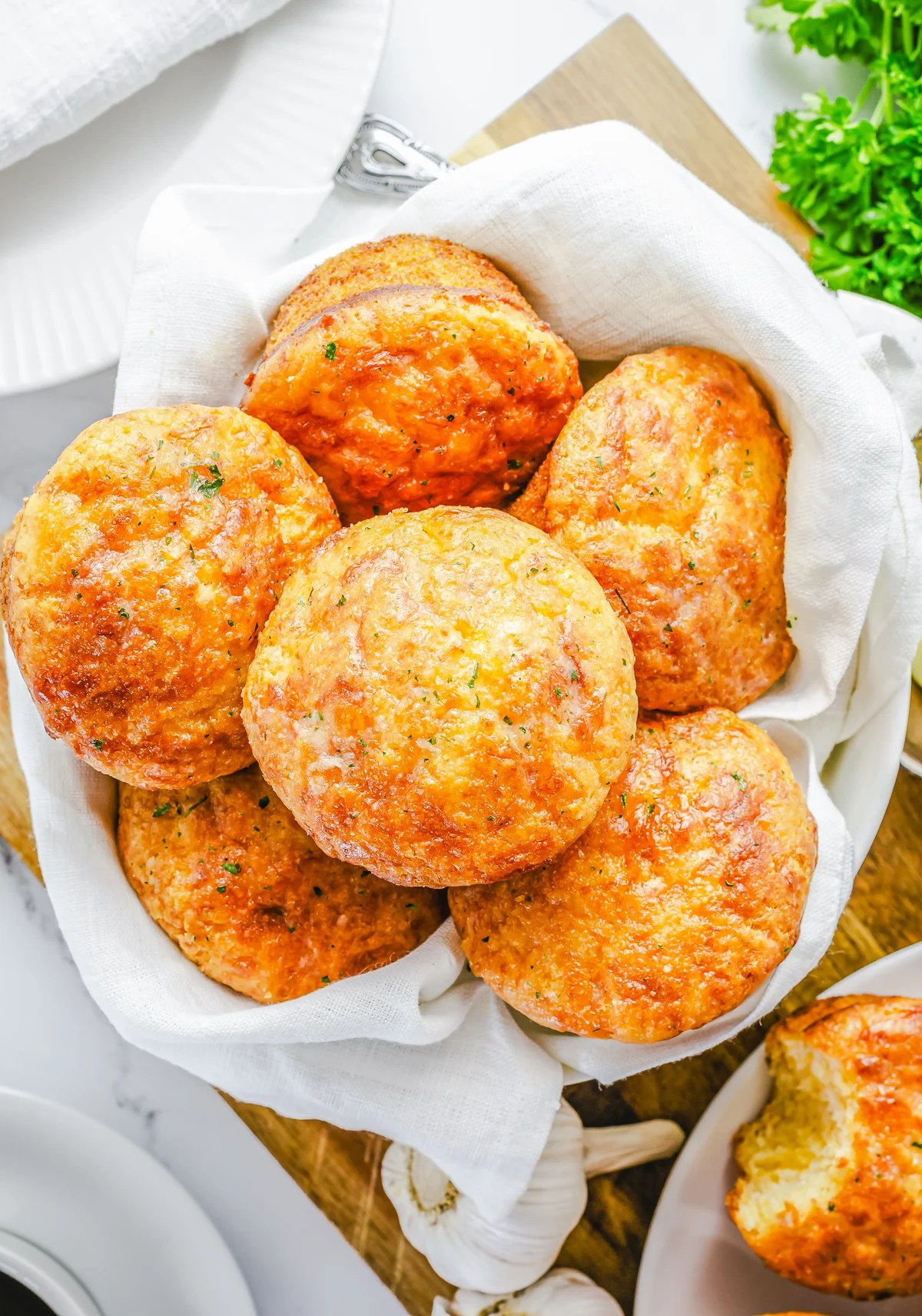 Overhead photo of Garlic Cheese Muffins in basket.