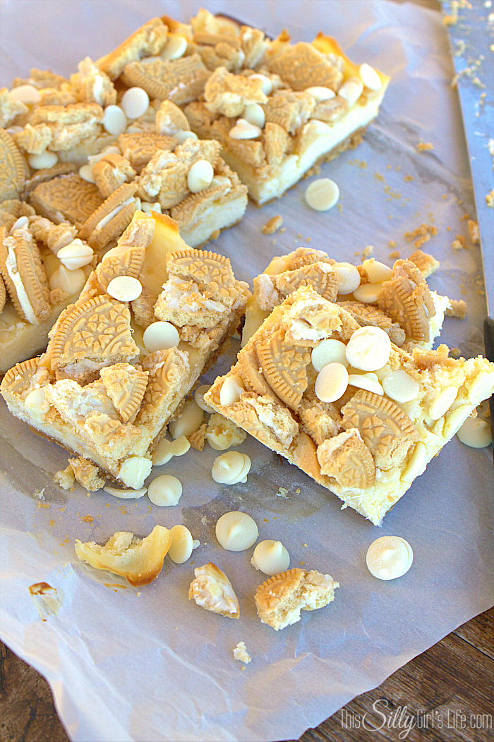 Golden Oreo White Chocolate Cheesecake Bars, golden Oreo crust with a smooth cheesecake filling studded with white chocolate chips! - ThisSillyGirlsLife.com