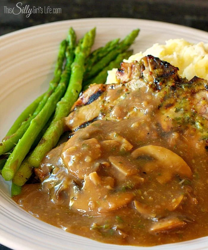The Best Mushroom Gravy, button mushrooms, roasted garlic and herbs makes this gravy a knock out! - ThisSillyGirlsLife.com #MushroomGravy