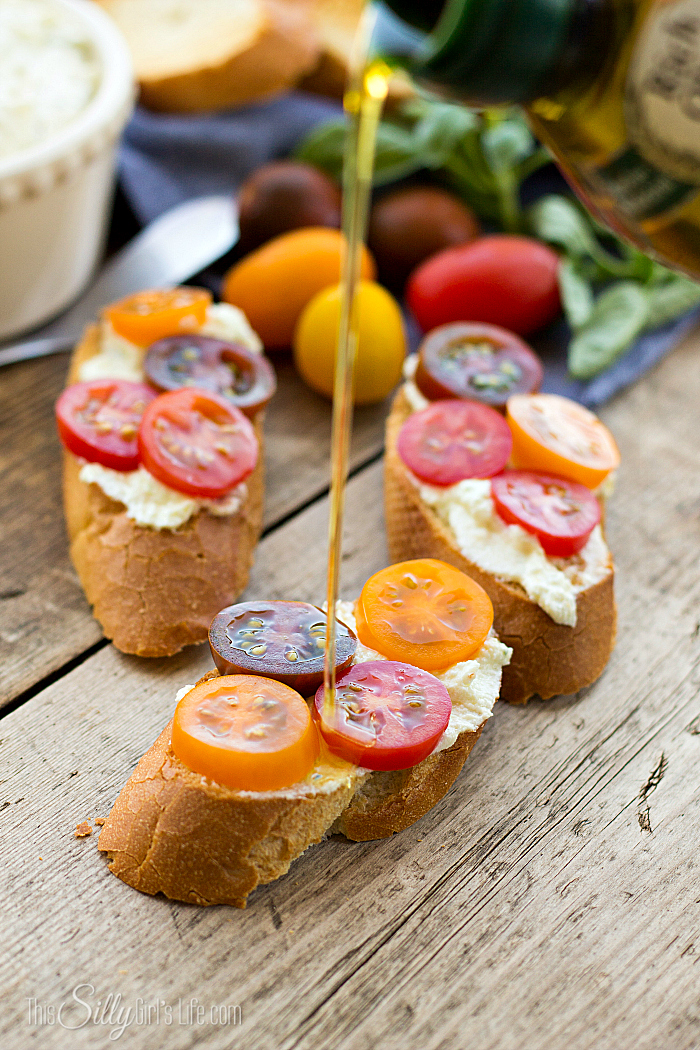 Creamy Goat Cheese Bruschetta, goat cheese and cottage cheese blended together, smeared on toasted baguette and topped with tomatoes, a yummy app or side dish! - ThisSillyGirlsLife.com #bruschetta #goatcheese