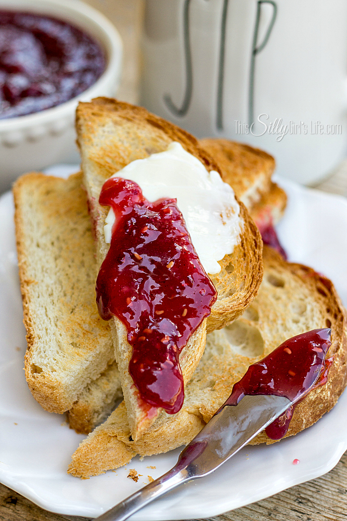 Whole Berry Raspberry Curd, sweet and tart this condiment is made with fresh raspberries and is the perfect ingredient for pastry fillings or just smeared on your morning toast! - ThisSillyGirlsLife.com #curd #raspberrycurd #summerrecipes #berries