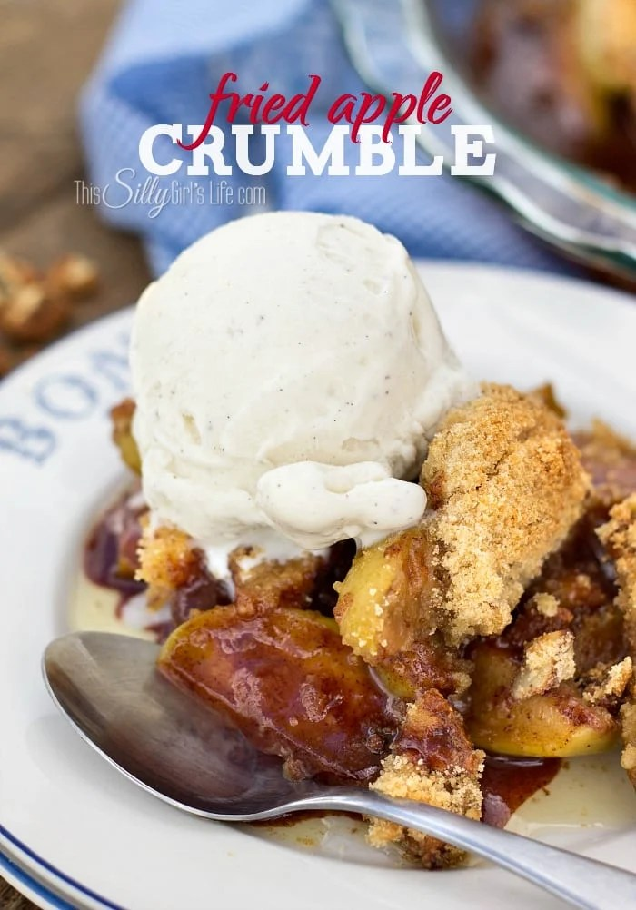 Fried Apple Crumble on plate with spoon topped with ice cream