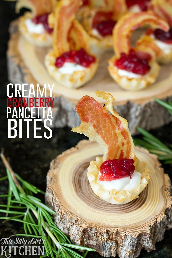 Creamy Cranberry Pancetta Bites, flavored goat cheese in phyllo cups with whole berry cranberry sauce and crispy pancetta! from ThisSillyGirlsLife.com #thanksgiving