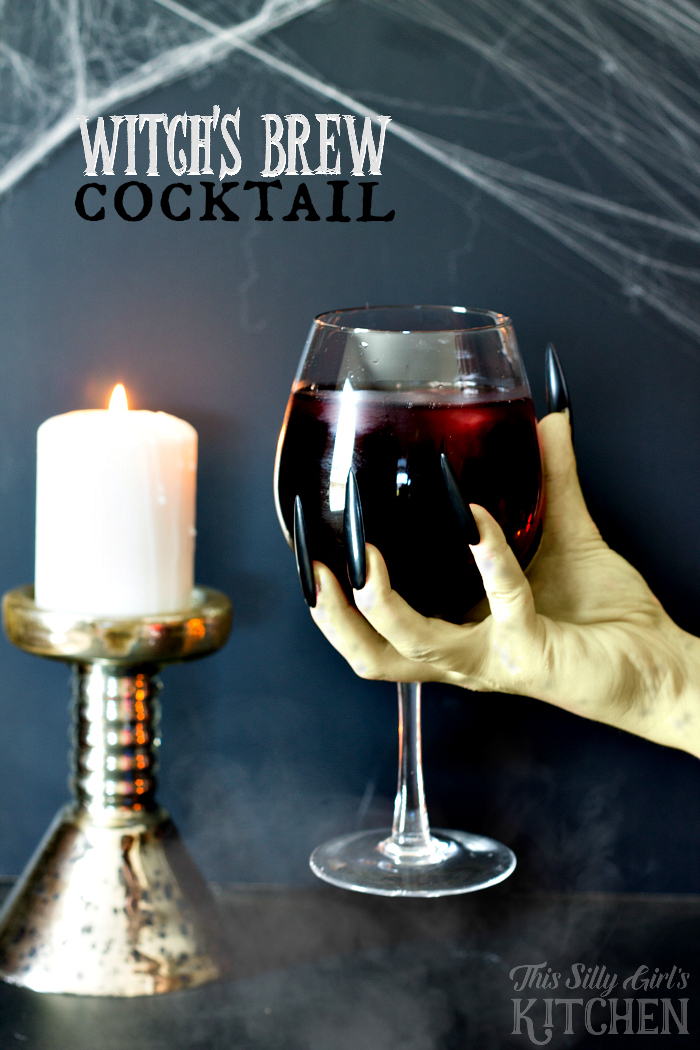 Witch's Brew Cocktail, do you dare to try this bewitching cocktail? It's delicious, I promise, just one little sip! Glacier Berry Lemonade, whipped cream vodka and my fruity twist... cranberry juice ice cubes! from ThisSillyGirlsLife.com #mikesVIP #ad @mikeshard