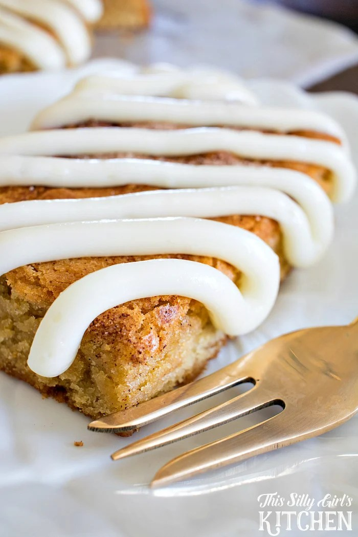 Cinnamon Roll Blondies, blondie batter swirled with cinnamon sugar and topped with a luscious cream cheese icing! from ThisSillyGirlsLife.com