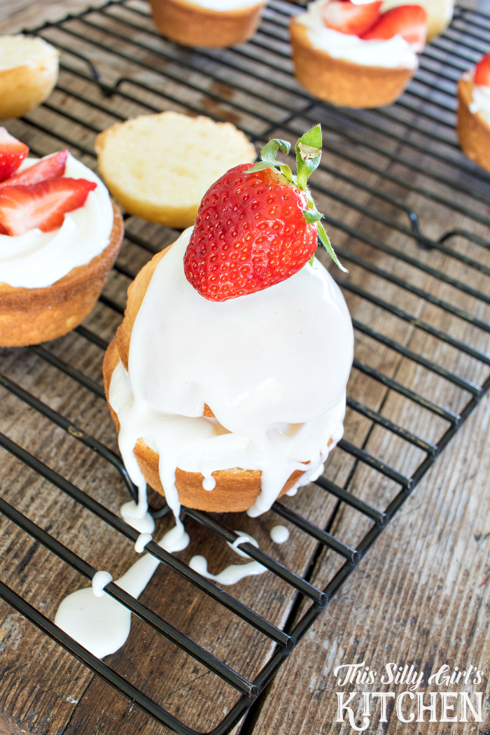 Strawberry Shortcake Cupcakes, white cake sliced in half, stuffed with vanilla frosting and fresh strawberries, drizzled with a vanilla frosting glaze! from ThisSillyGirlsLife.com #ad