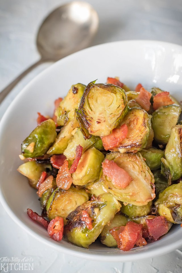 Roasted Brussel Sprouts with Bacon tossed in a sweet and tangy glaze is sure to be a huge hit on any dinner table. #recipe from thissillygirlskitchen.com #roastedbrusselsproutswithbacon #bacon #brusselsprouts #roastedbrusselsprouts