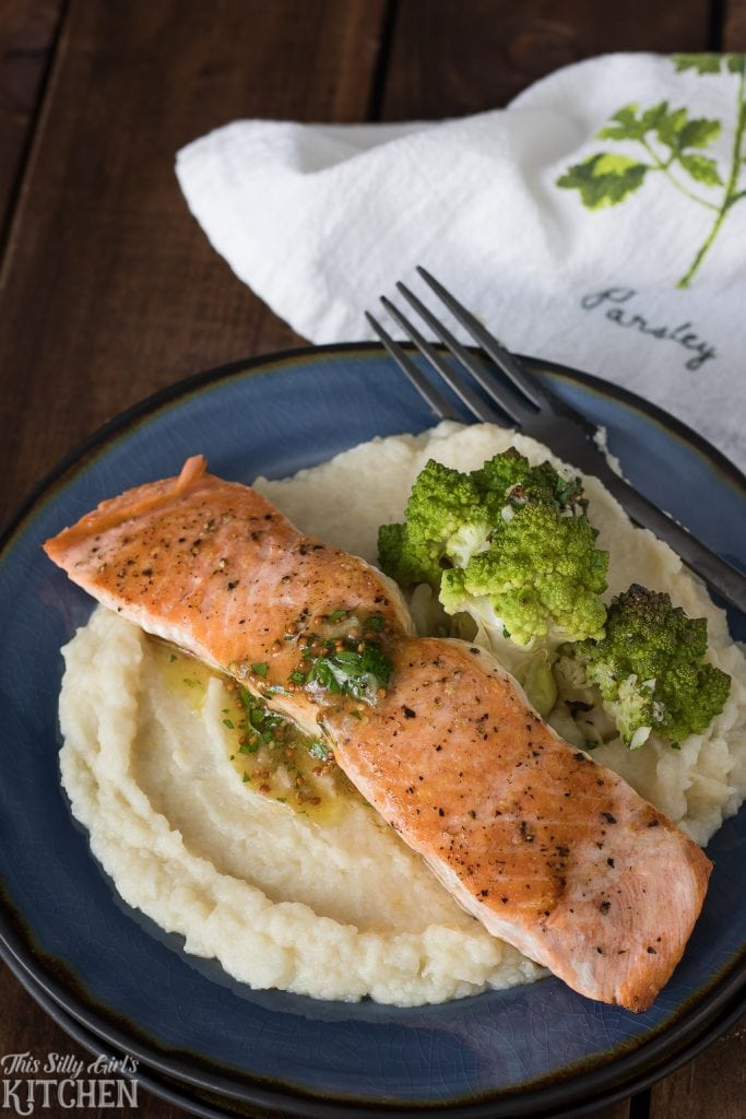 Pan Seared Salmon with Maple Vinaigrette is served over mashed cauliflower, making this dish a great starch alternative. Recipe from ThisSillyGirlsKitchen.com