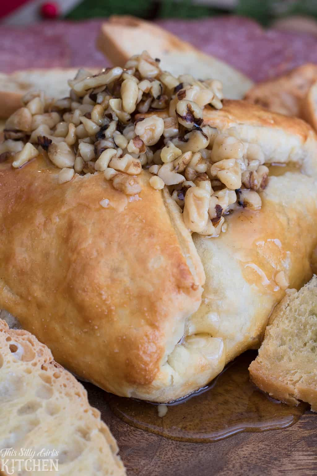 Wrapped Baked Brie Topped with Honey and Walnuts