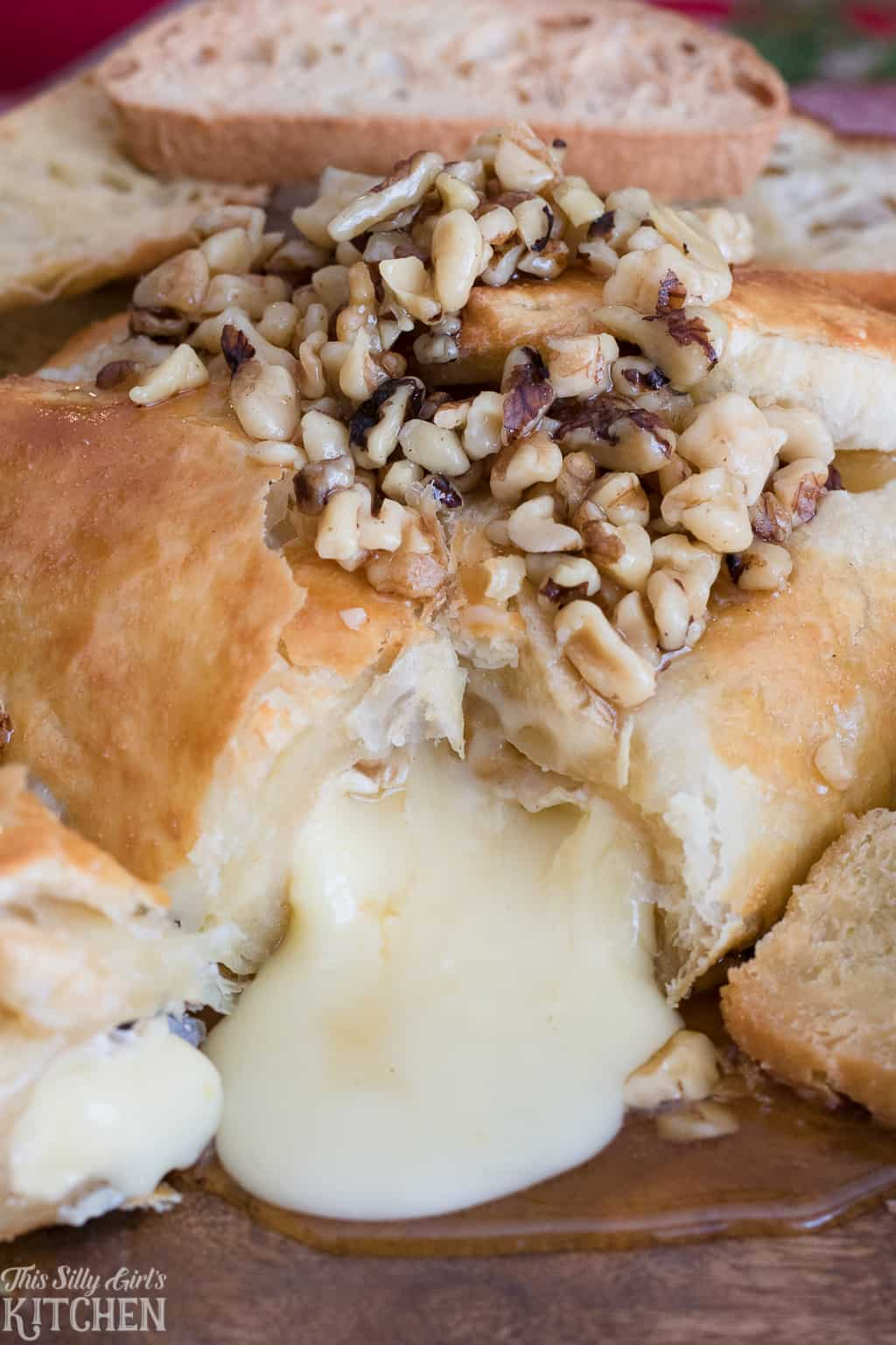 Baked Brie close up with cheese oozing out