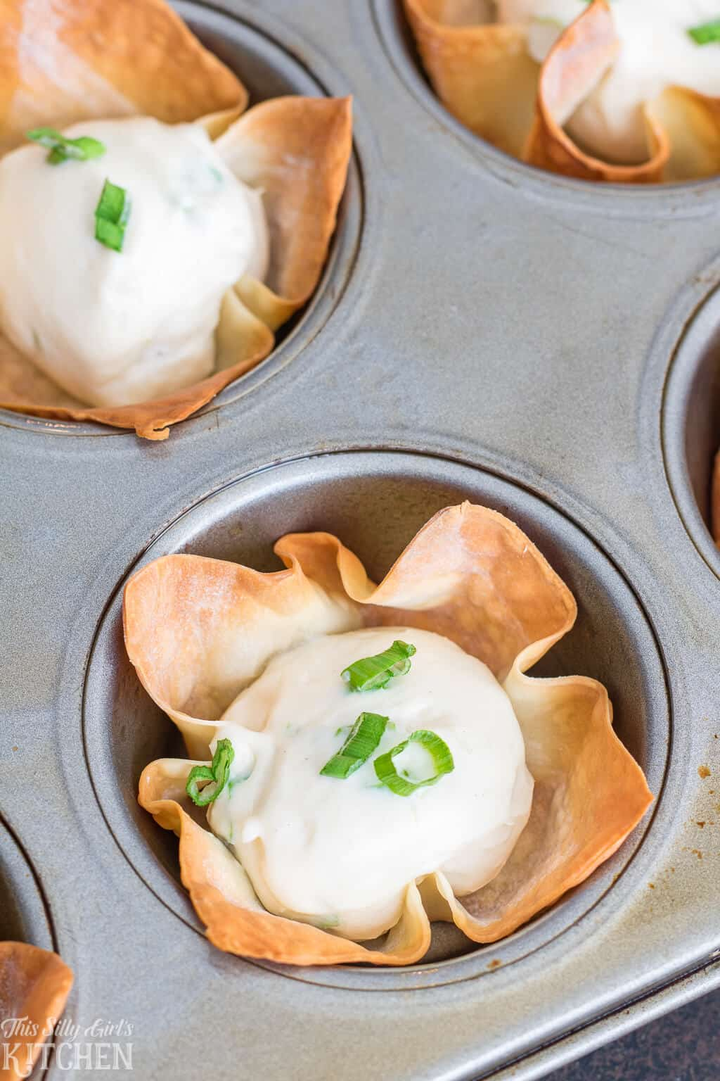 The Best Baked Cream Cheese Wonton Cups, better than takeout and ready in under 20 minutes! #Recipe from ThisSillyGirlsKitchen.com #creamcheese #wontons #wontoncups #appetizer