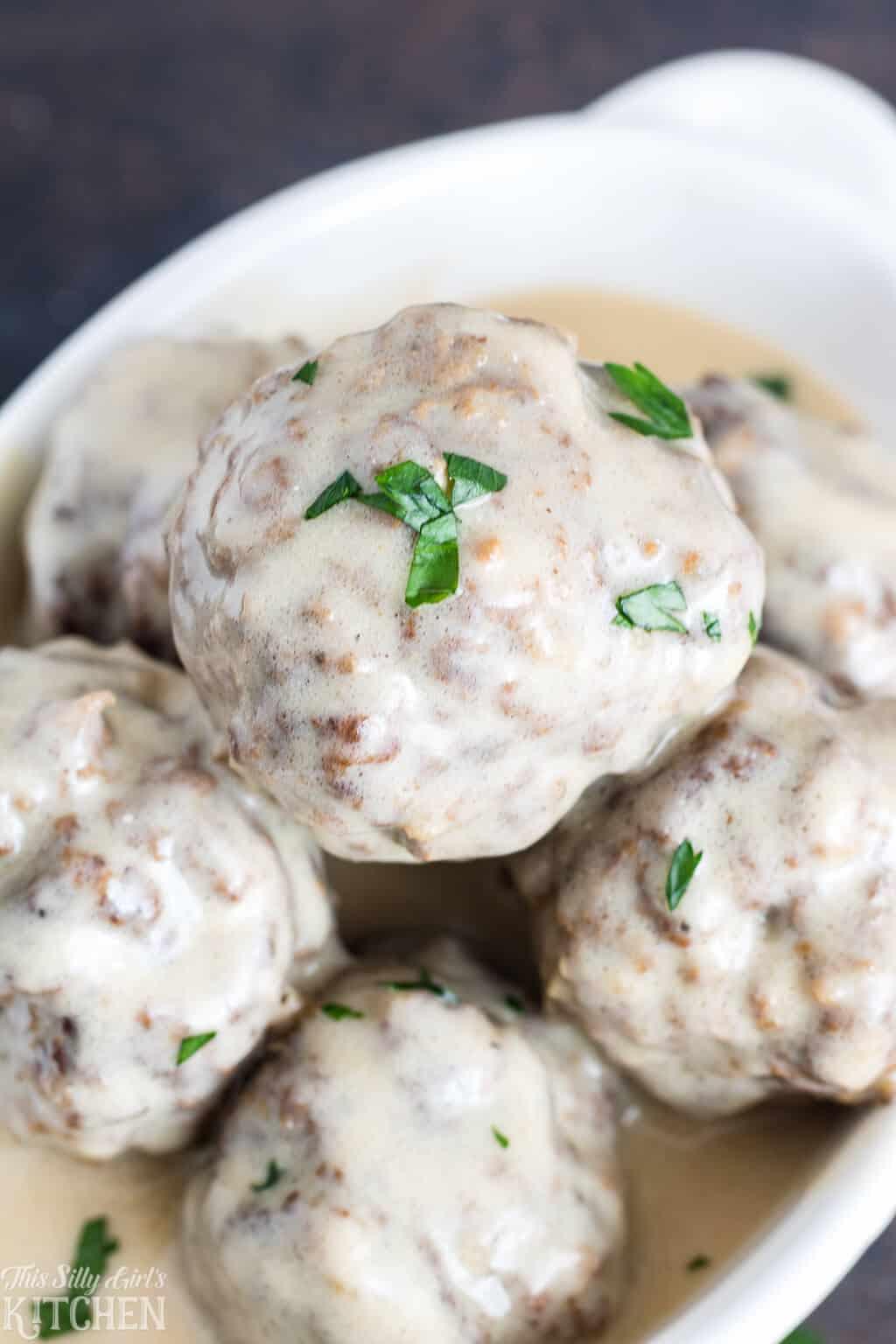 close up of meatballs in cream sauce