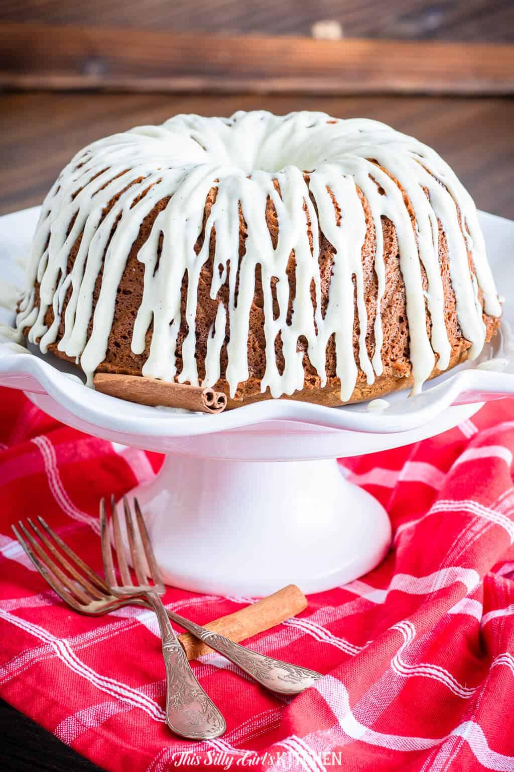 Coffee Cake on cake stand garnished with cinnamon sticks