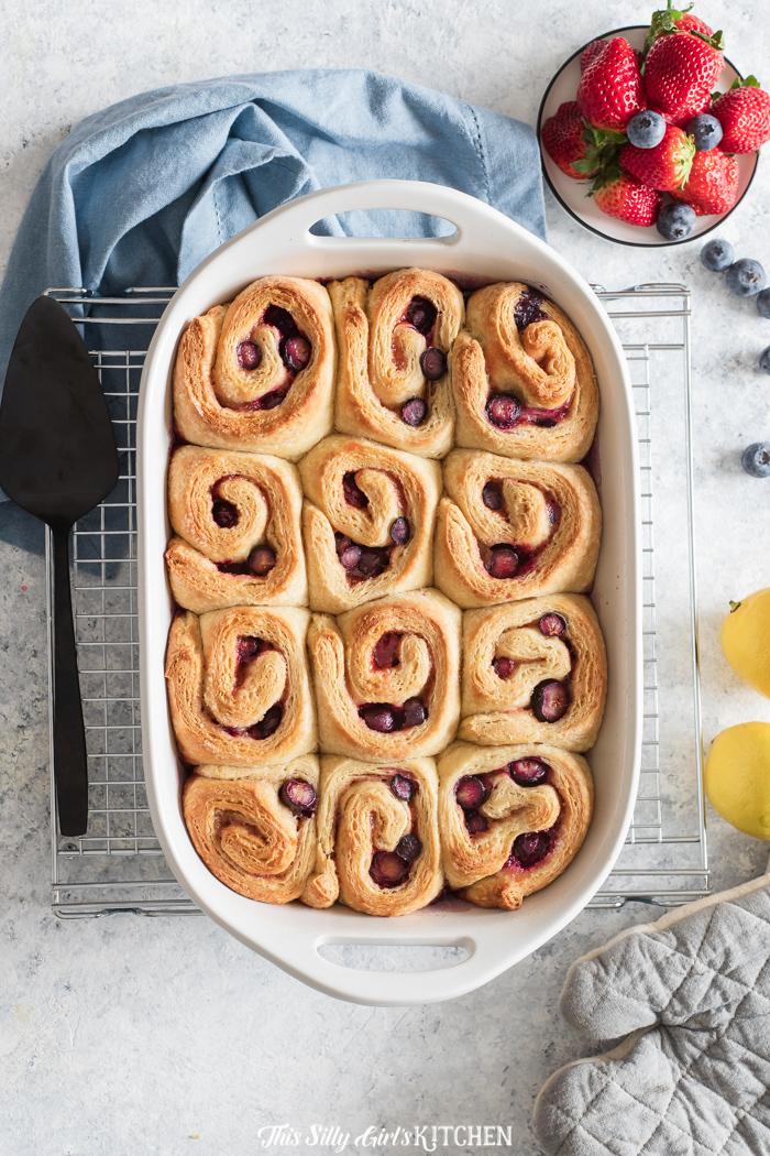 Overhead of unglazed sweet rolls in baking pan