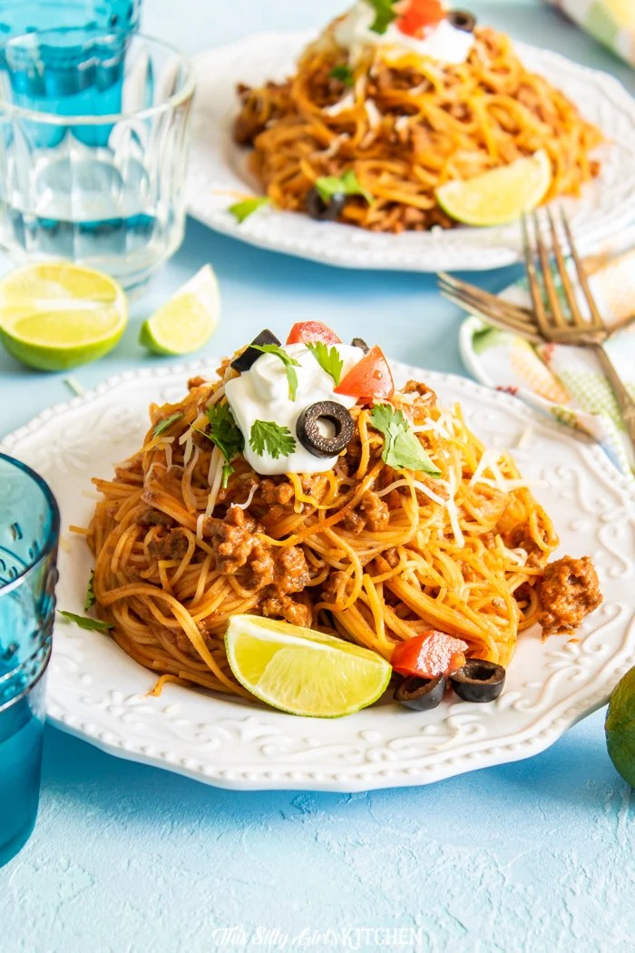 White plate with Taco Pasta dressed with toppings