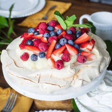 Berry Pavlova recipe on cake stand square image