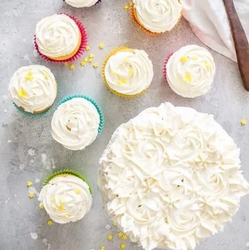 Square image of the Best Fluffy Buttercream Frosting on cupcakes and a cake