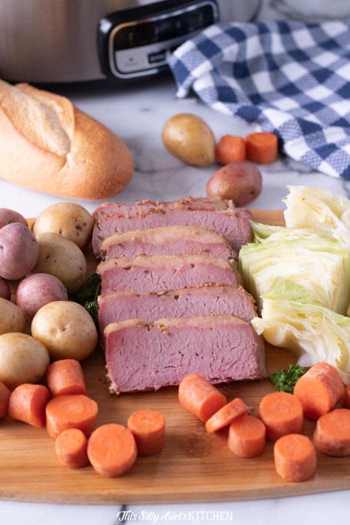 Sliced Corned Beef Dinner on cutting board