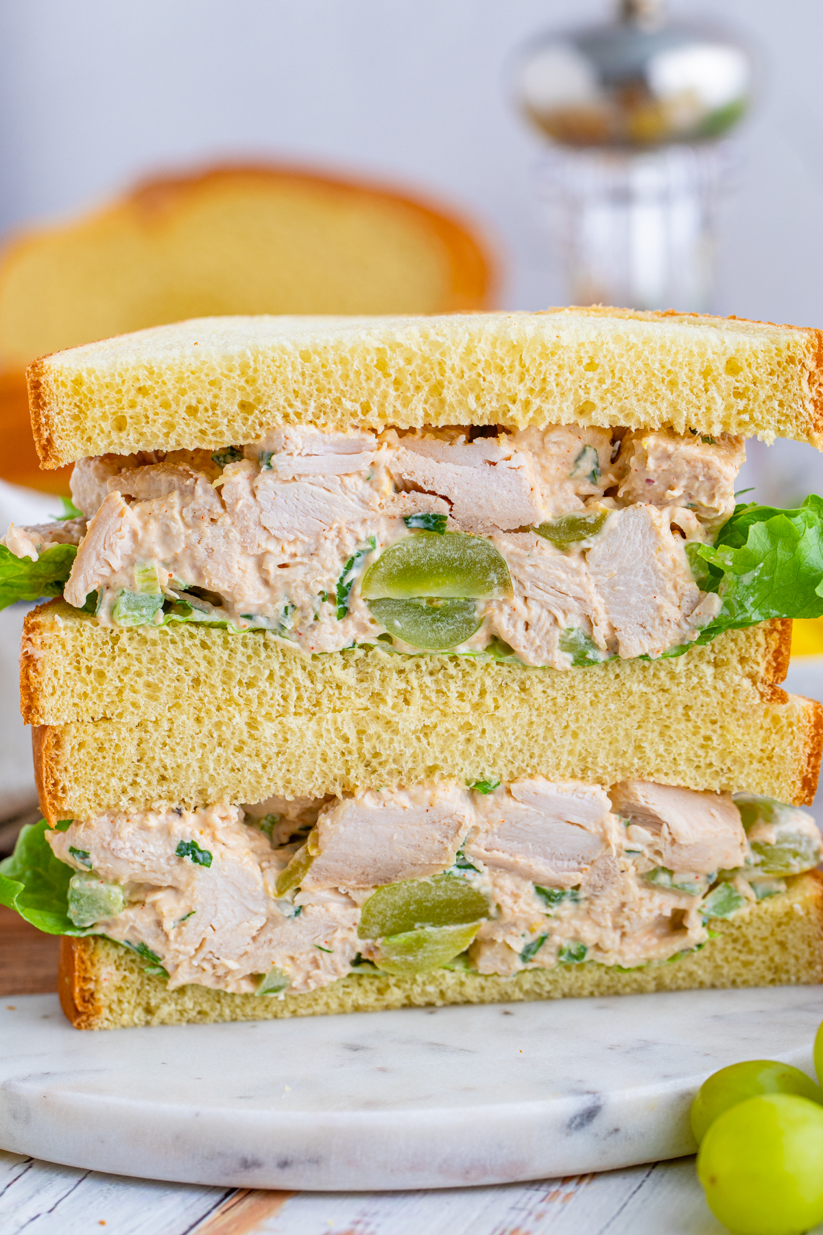 Sliced open Chicken Salad with Grapes sandwich