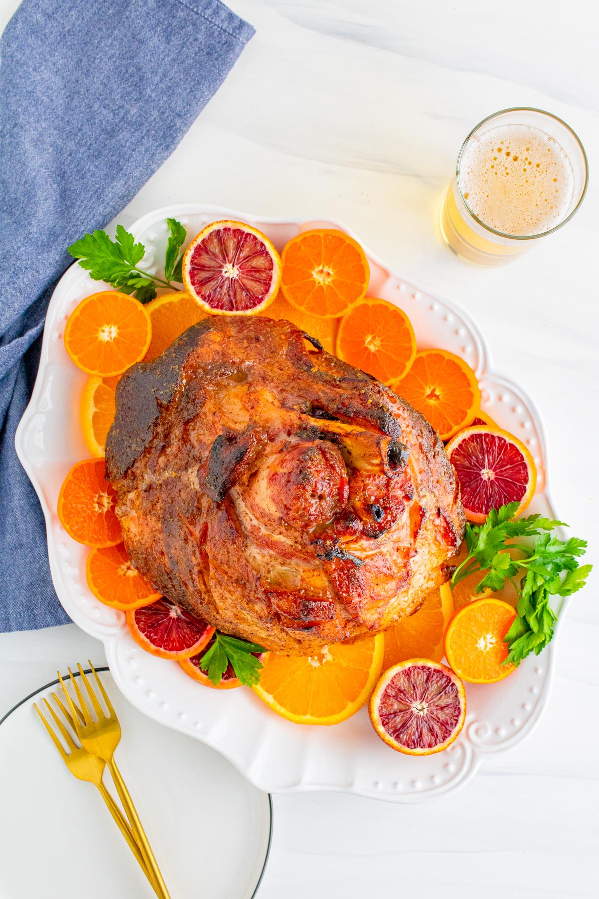 Overhead of finished Honey Baked Ham on oranges