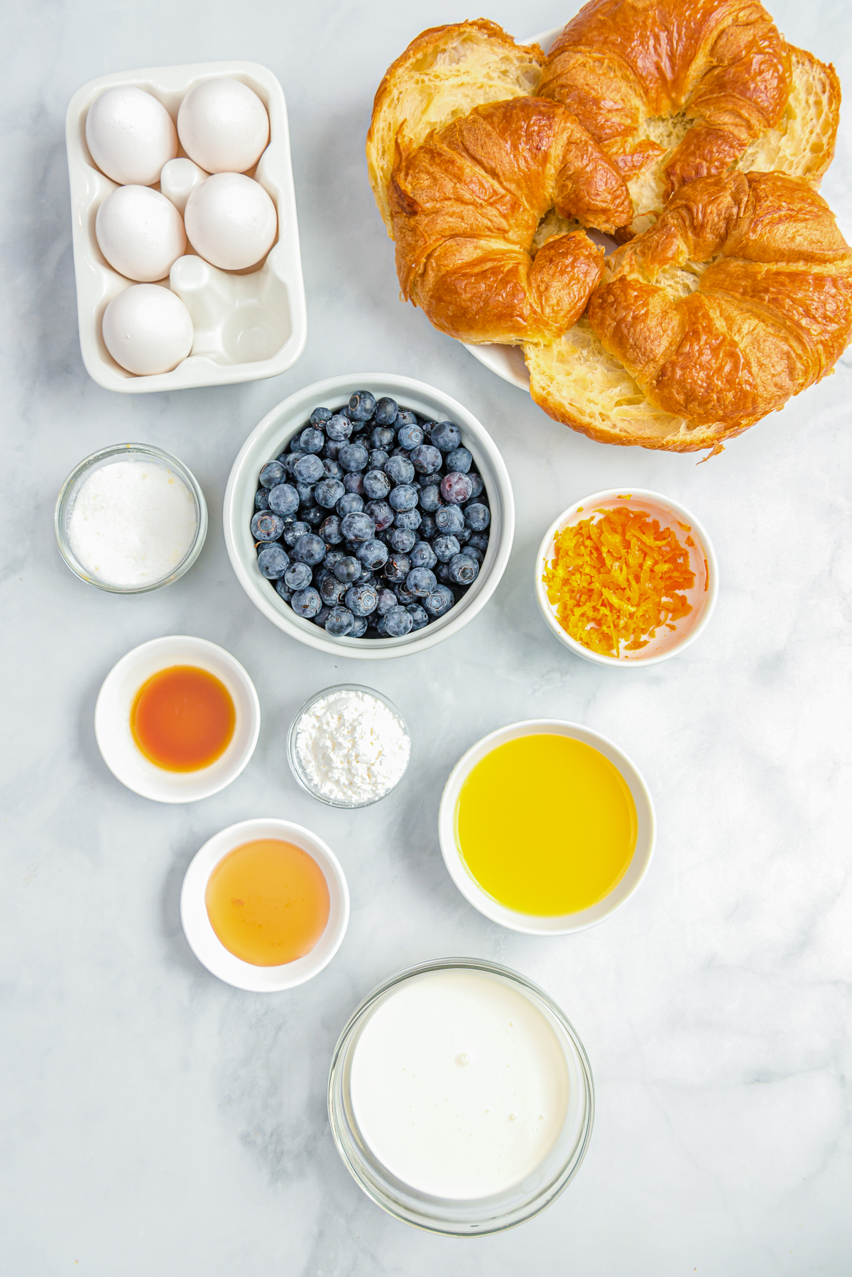 Ingredients needed to make Blueberry Croissant French Toast
