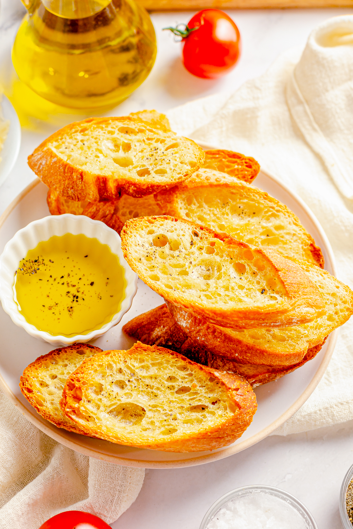 How to Make Crostini, finished on white plat with dipping oil.