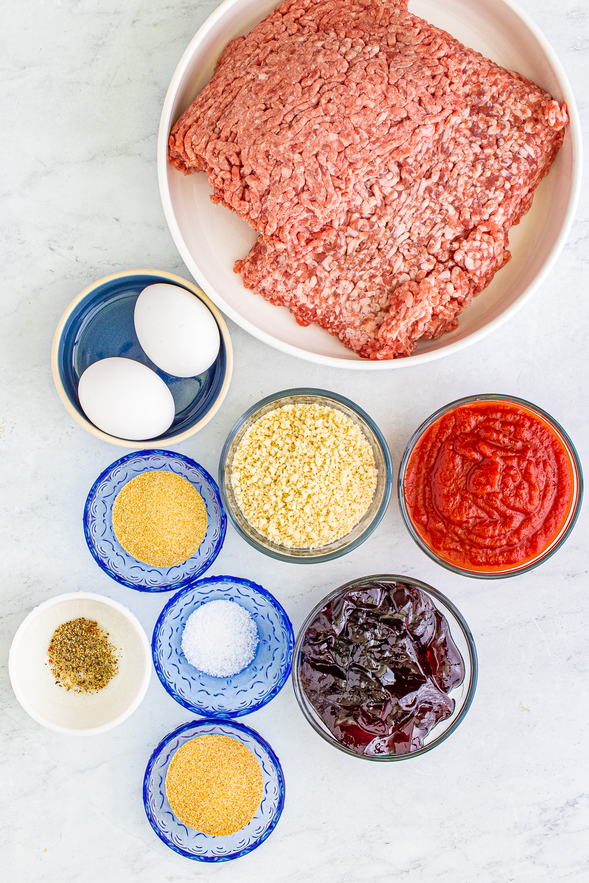 Ingredients needed to make Crock Pot Grape Jelly Meatballs.