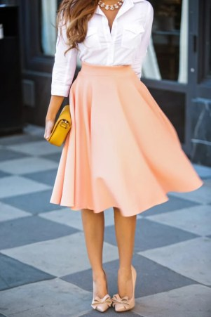 Mad Men Fashion with a Pink Flowy Skirt and White Button Down with Soft Pink Heels