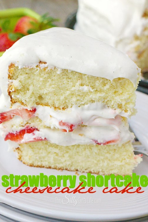 Strawberry Shortcake Cheesecake Cake, creamy cheesecake sandwiched between layers of homemade vanilla cake, fresh sliced strawberries and whipped frosting. Heaven on a plate! - ThisSillyGirlsLife.com #StrawberryShortcake #Cheesecake #CheesecakeCake