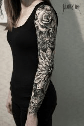 Black flower sleeve tattoo