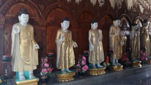 Rows of buddhas in Dharmikarama Burmese Temple