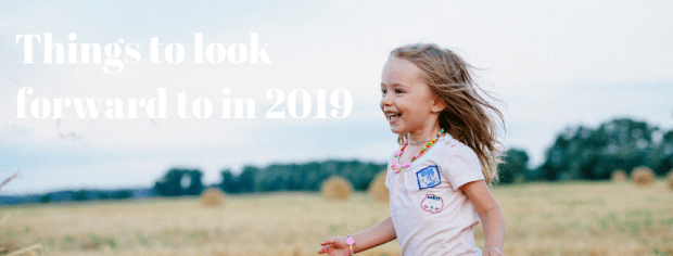 """Things I'm looking forward to in 2019 - young smiling girl running through field with text """"things to look forward to in 2019"""""""
