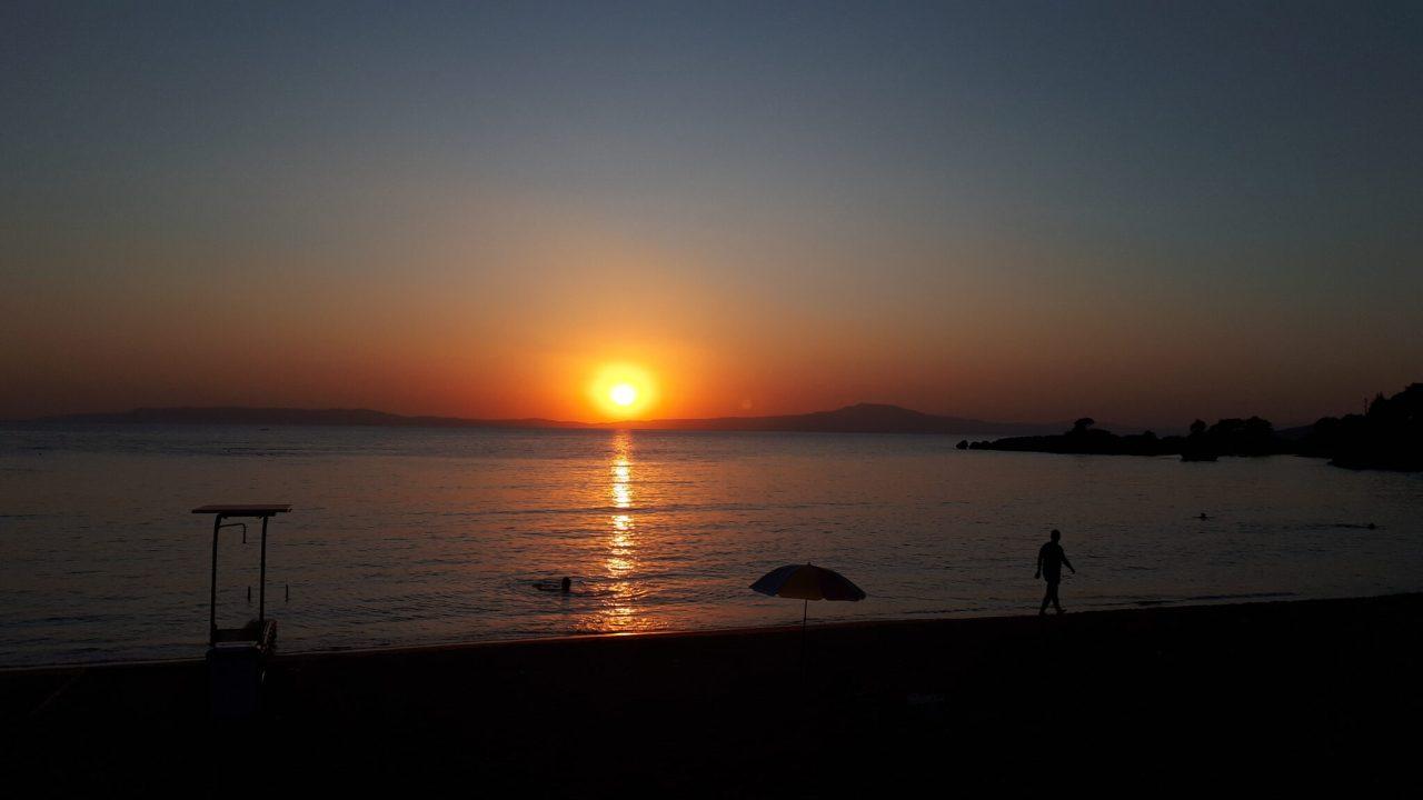 sun sets over stoupa beach