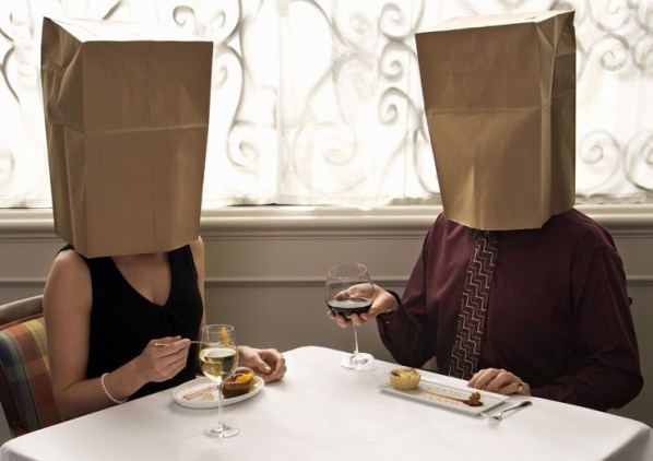 couple-at-restaurant-bag-on-head