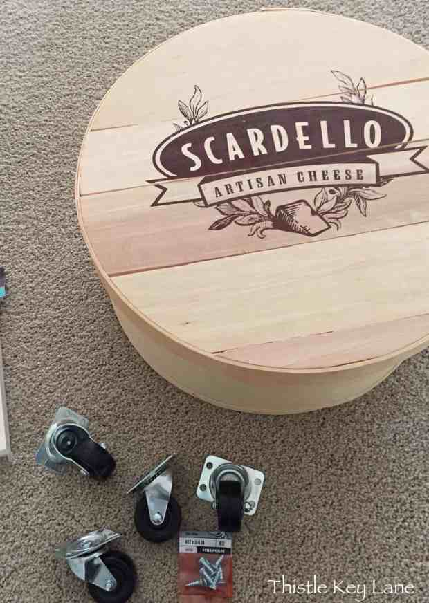 Wine and cheese table with casters.