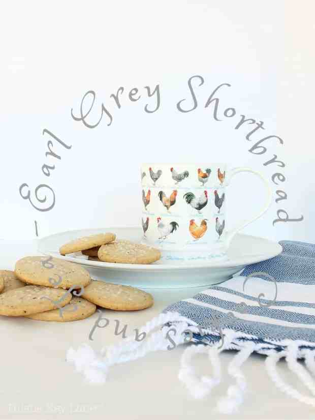 Earl Grey Shortbread cookies on a plate with tea cup and tea towel.
