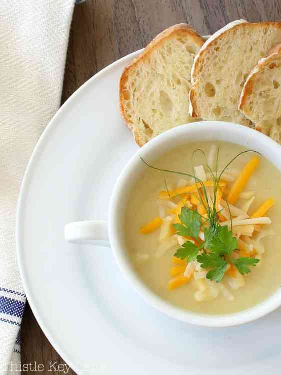 Potato leek soup with cheese, chives and parsley.