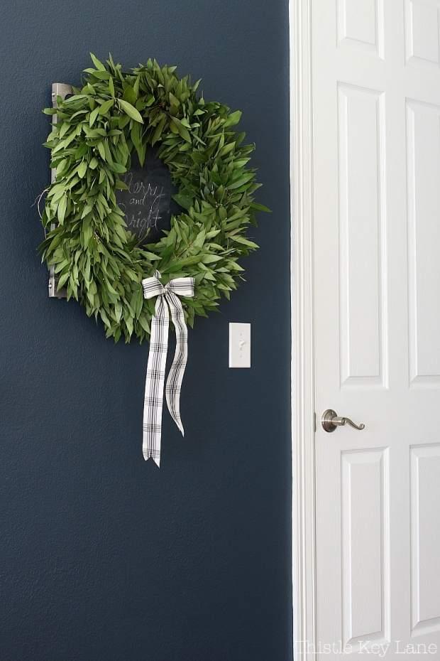 Fresh bayleaf wreath with a plaid ribbon.