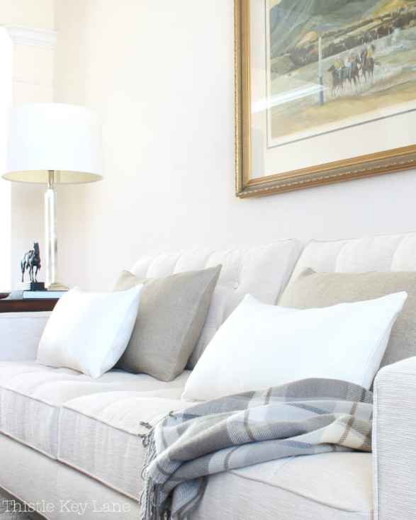 Vary the size of pillows and textures for neutral decor.