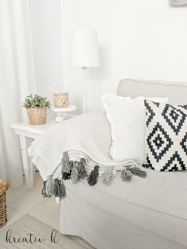 Kreativ K Beautiful Ikea hack tassel blanket.