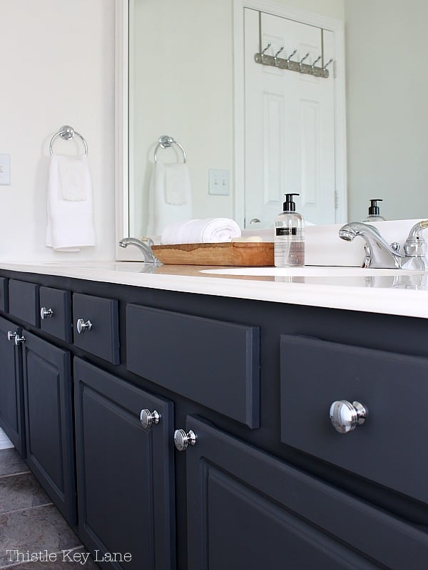 Dark charcoal cabinets feature chrome pulls.