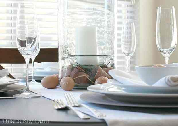 Simple table setting with bunny face eggs.