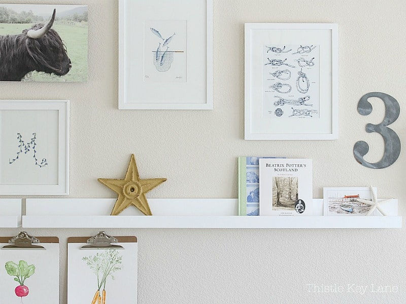 Gallery wall ideas with a shelf.