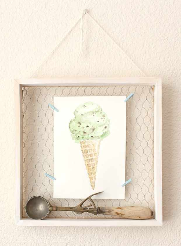 Fun way to display art and a vintage ice-cream scoop.