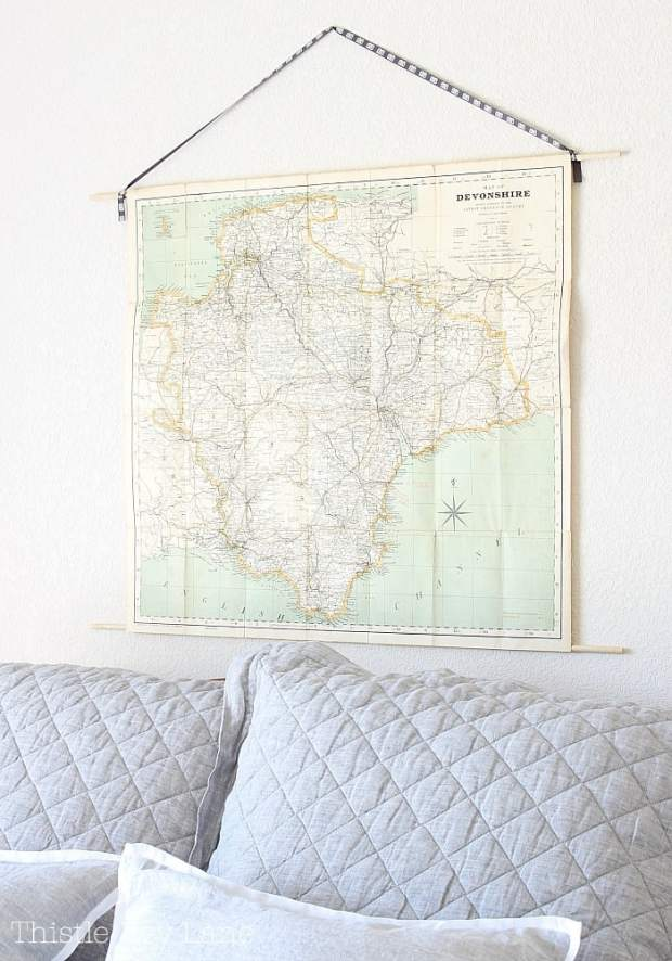 Wall map with a ribbon for a hanger.