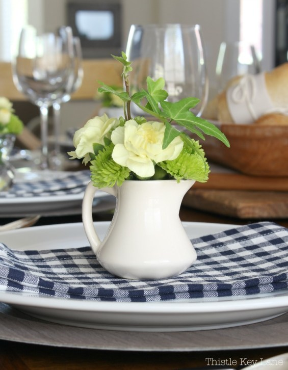 Use vintage creamers as vases at each place.