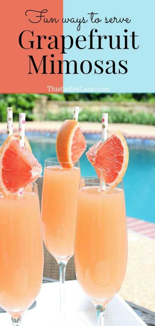 Mimosas in Champagne flutes, fresh grapefruit slices and a pool background.
