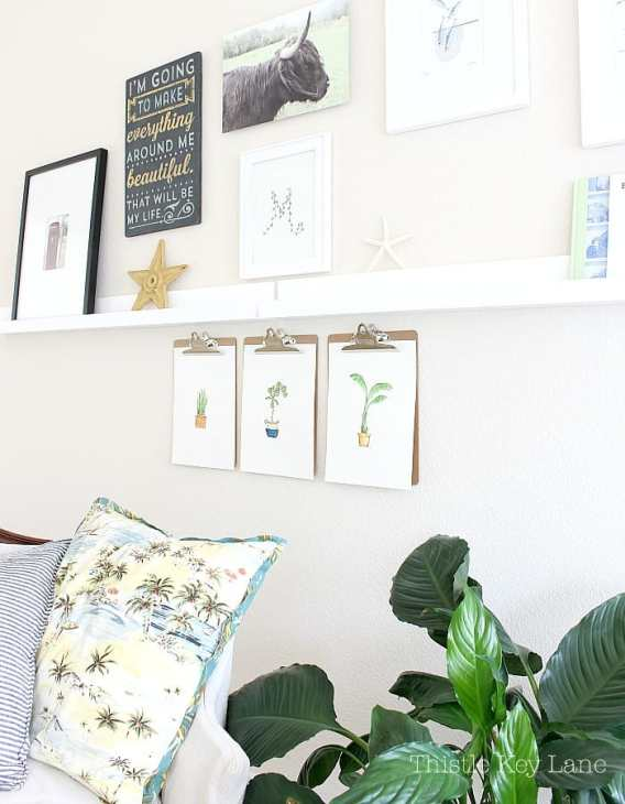Gallery wall with simple and fun art. Houseplant watercolors by Thistle Key Lane